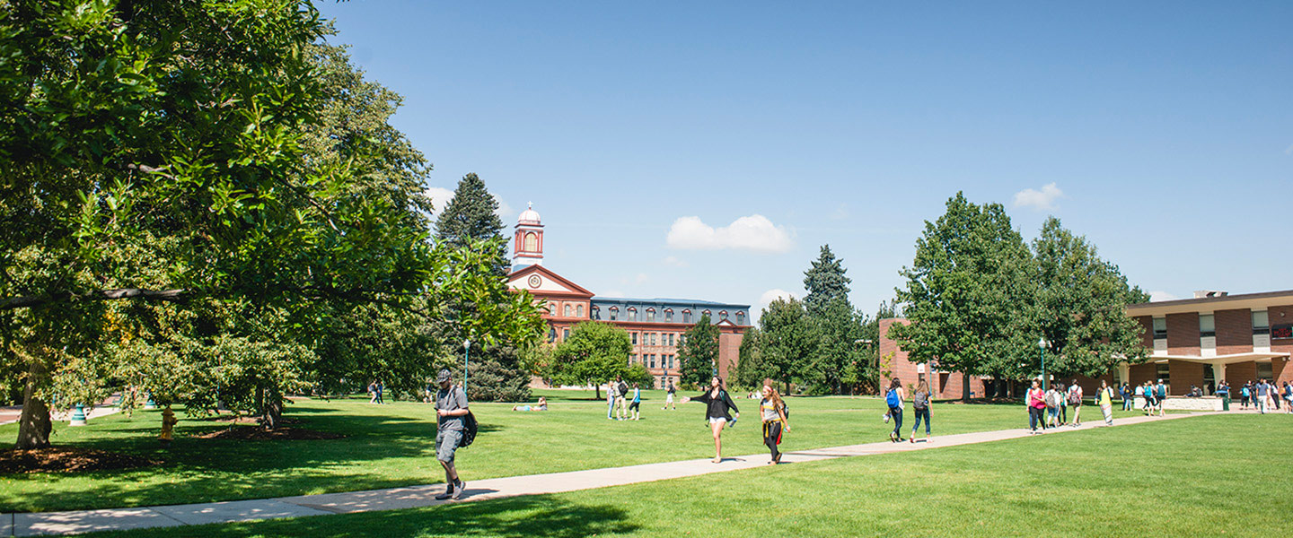 students walk across the quad in early fall