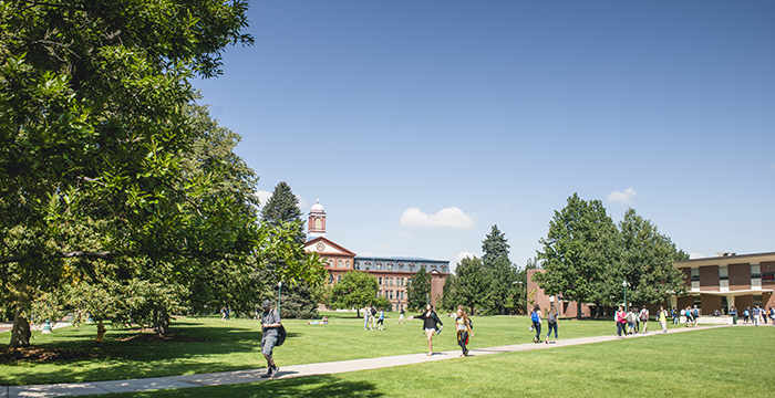 students cross quad