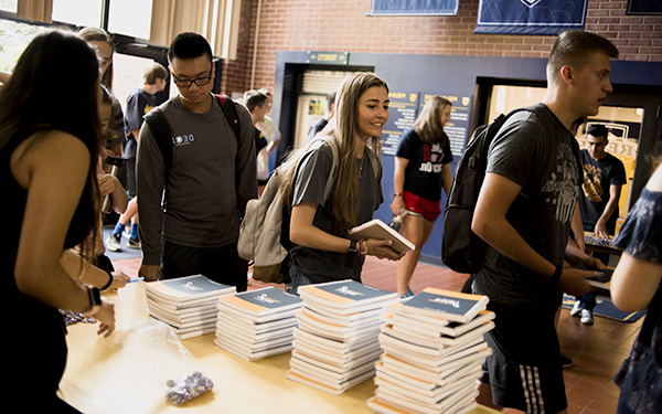 First Year students stand in line to pick up notebooks