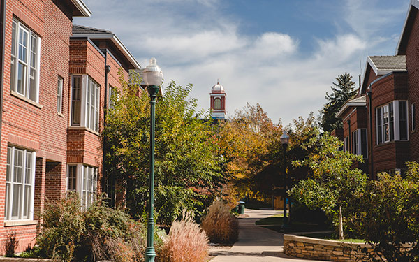 view down walkway between residence village buildings